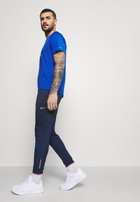 Nike Performance - ELITE PANT - Tracksuit bottoms - midnight navy/reflective silver - 3