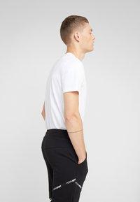 Plein Sport - JOGGING TROUSERS STATEMENT - Jogginghose - black - 3