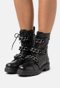 Kurt Geiger London - STORM - Lace-up ankle boots - black - 0