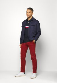 Tommy Hilfiger Tailored - FLEX SLIM FIT PANT - Trousers - red - 1