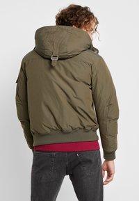 Calvin Klein Jeans - FUR TRIMMED HOODED DOWN BOMBER - Down jacket - dark green - 3