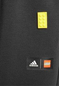 adidas Performance - X LEGO TRAINING WORKOUT - Pantalon de survêtement - black - 3