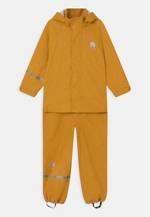BASIC RAINWEAR SOLID SET UNISEX - Rain trousers - mineral yellow
