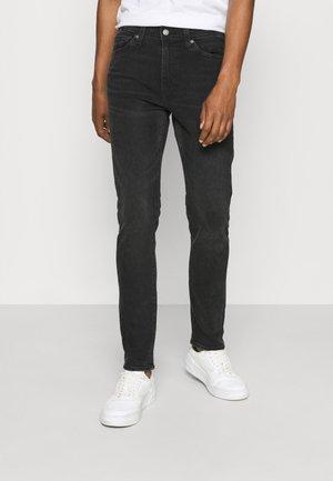 510™ SKINNY - Skinny džíny - black denim