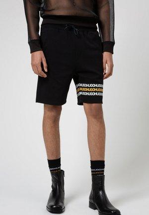 DAKUMI - Shorts - black