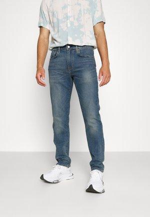 502™ TAPER - Jeans Tapered Fit - dorian adv