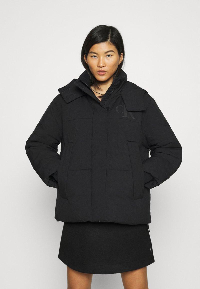 Calvin Klein Jeans - ECO PUFFER JACKET - Vinterjakke - black