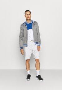 Calvin Klein Golf - TREVINO  - Polo shirt - white/nautical blue - 1