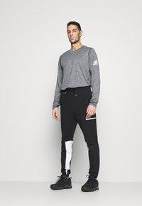 adidas Performance - SPORTSWEAR PRIMEGREEN PANTS - Träningsbyxor - black/white - 1