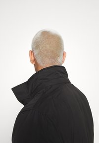 Tommy Jeans - TECH BOMBER UNISEX - Giacca invernale - black - 4