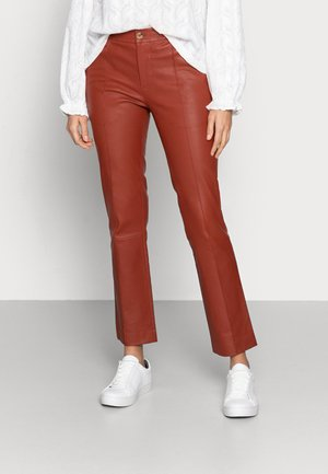 DOGUNA - Leather trousers - tulip