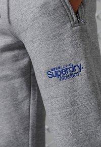 Superdry - CORE LOGO ATHLETICS - Tracksuit bottoms - soft grey marl - 2