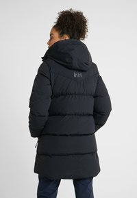 Helly Hansen - ADORE PUFFY - Winter coat - black - 2