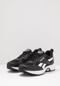 Reebok - PHEEHAN - Neutral running shoes - black/white - 2