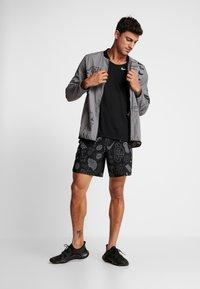 Nike Performance - RISE TANK - Sports shirt - black/silver - 1