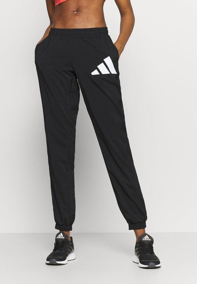 BOS PANT - Verryttelyhousut - black/white