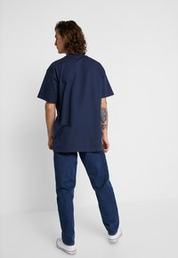 Carhartt WIP - NEWEL PANT MAITLAND - Relaxed fit jeans - blue stone washed - 2