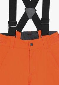 Ziener - ANDO JUNIOR - Snow pants - bright orange - 5
