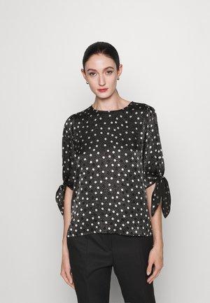 CILIRAS - T-shirt imprimé - black
