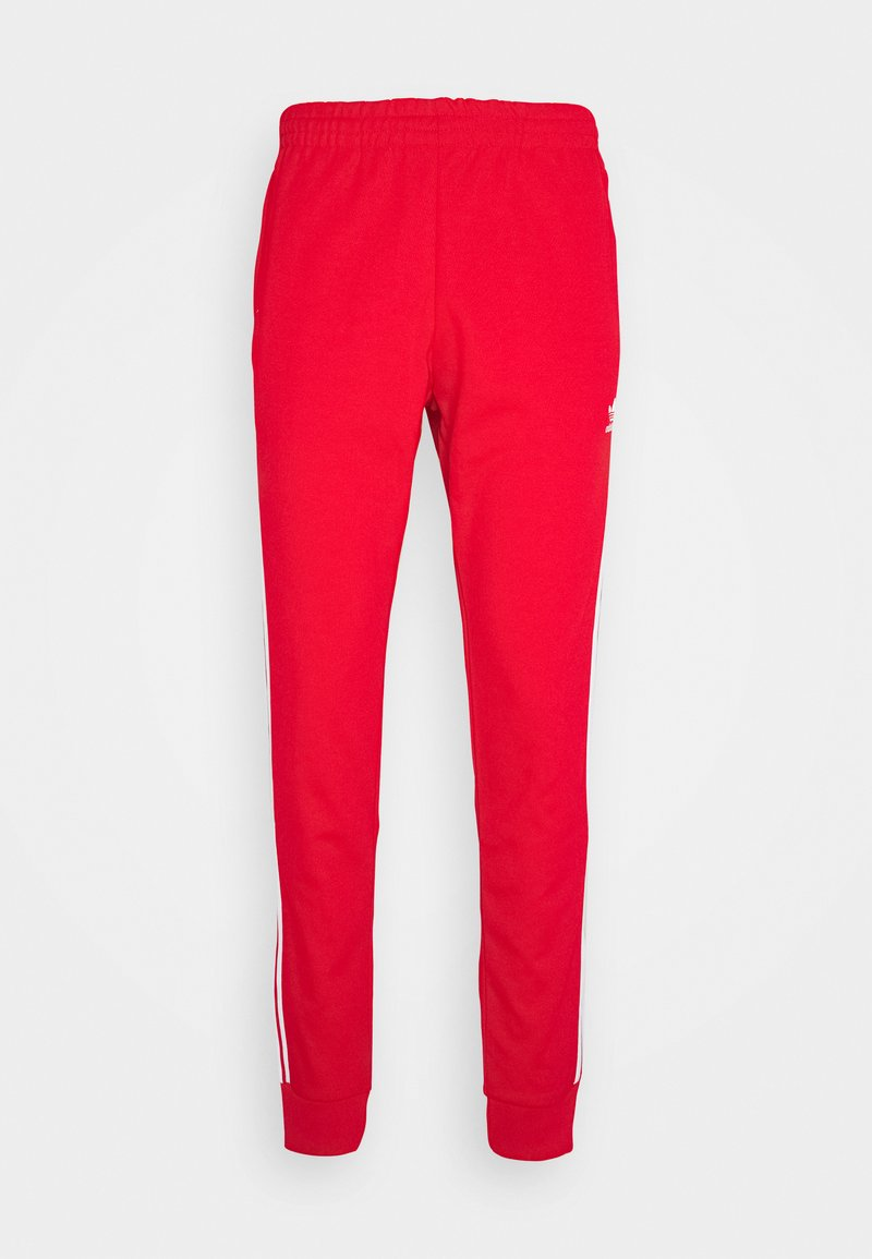 adidas Originals - UNISEX - Pantalon de survêtement - scarle/white