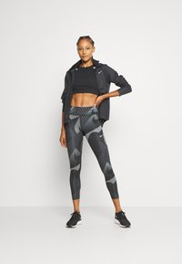 Nike Performance - FAST 7/8 RUNWAY - Leggings - black/black/reflective silver - 1