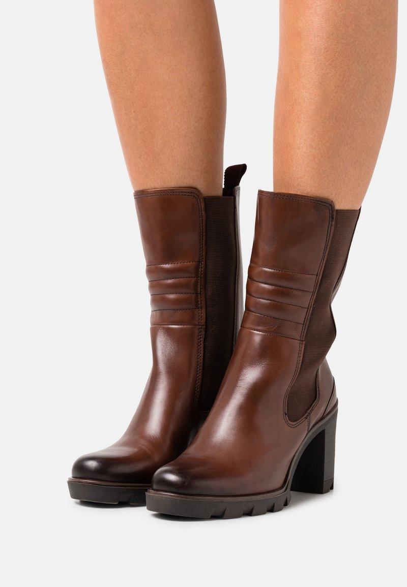 Marco Tozzi - Classic ankle boots - cognac antic