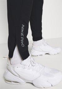 Nike Performance - FLEX PANT  - Tracksuit bottoms - black - 3
