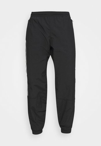 LOCK UP UNISEX - Pantaloni sportivi - black