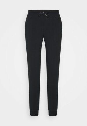 SOLE - Tracksuit bottoms - black