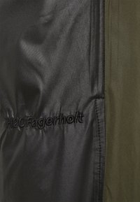 H2O Fagerholt - PUT ON TRACK PANTS - Kalhoty - black/army - 2
