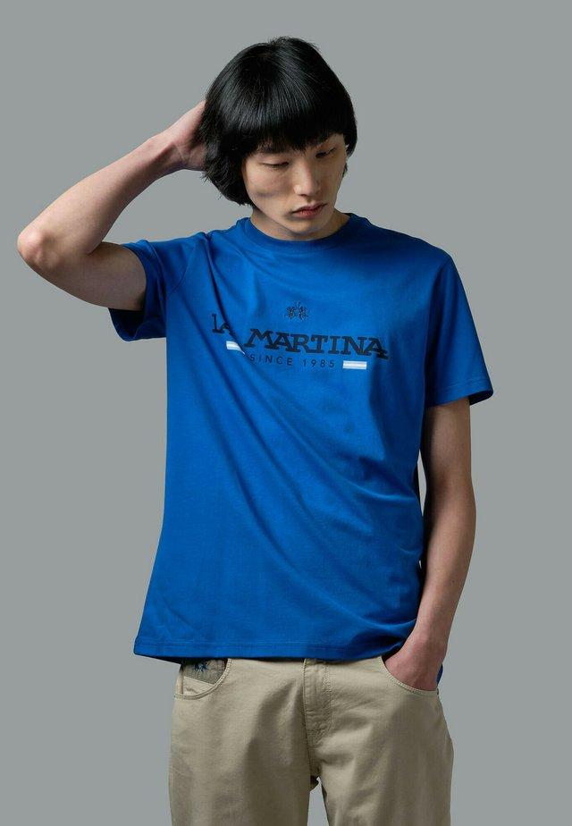 RANDAL - T-shirt con stampa - blue