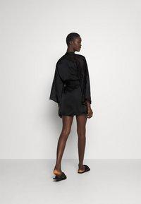 Hunkemöller - KIMONO  SLEEVE INSERT - Dressing gown - black - 2