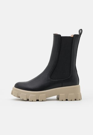 ELASTIC PROFILE BOOTS - Platform ankle boots - black/beige