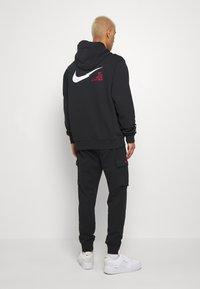 Nike Sportswear - PANT - Pantalones deportivos - black - 2
