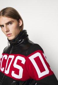 GCDS - LOGO MIX PUFFER - Winter jacket - black - 5