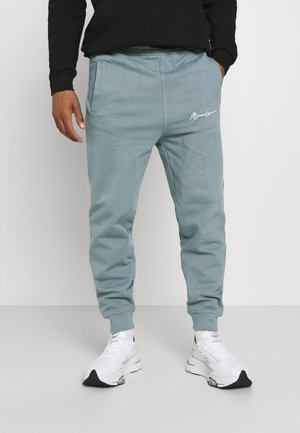 UNISEX ESSENTIAL SIGNATURE  - Tracksuit bottoms - dark green
