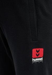 Hummel - HMLLGC GRAHAM - Tracksuit bottoms - black - 6