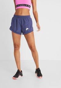 Nike Performance - TEMPO SHORT AIR - Sports shorts - sanded purple/white - 0