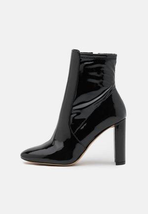 AURELLANE - Kotníkové boty - black