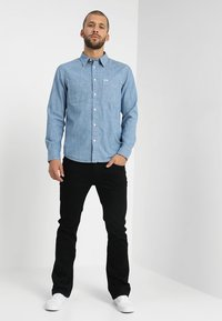 Lee - TRENTON - Straight leg jeans - black rinse - 1