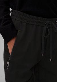Marc O'Polo - LONTTA - Tracksuit bottoms - black - 4