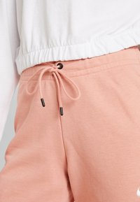 Nike Sportswear - PANT TIGHT - Tracksuit bottoms - pink quartz/white - 5