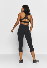 Reebok - LUX 3/4 - 3/4 sports trousers - black - 2