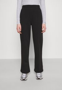 Pieces - PCCHILLI WIDE PANTS - Tracksuit bottoms - black - 0