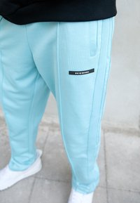 9N1M SENSE - STRIPE TRACK PANT UNISEX - Pantalon de survêtement - skyblue - 2