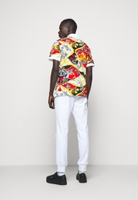 Versace Jeans Couture - PRINT BELT PAISLEY - Polo shirt - rosso - 2