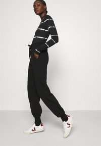 Gestuz - RUBI PANTS - Tracksuit bottoms - black - 3