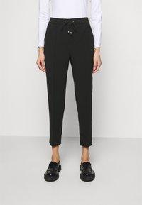 Filippa K - FIONA DRAPEY TROUSER - Kalhoty - black - 0