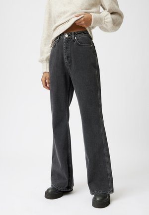 Flared Jeans - washed black