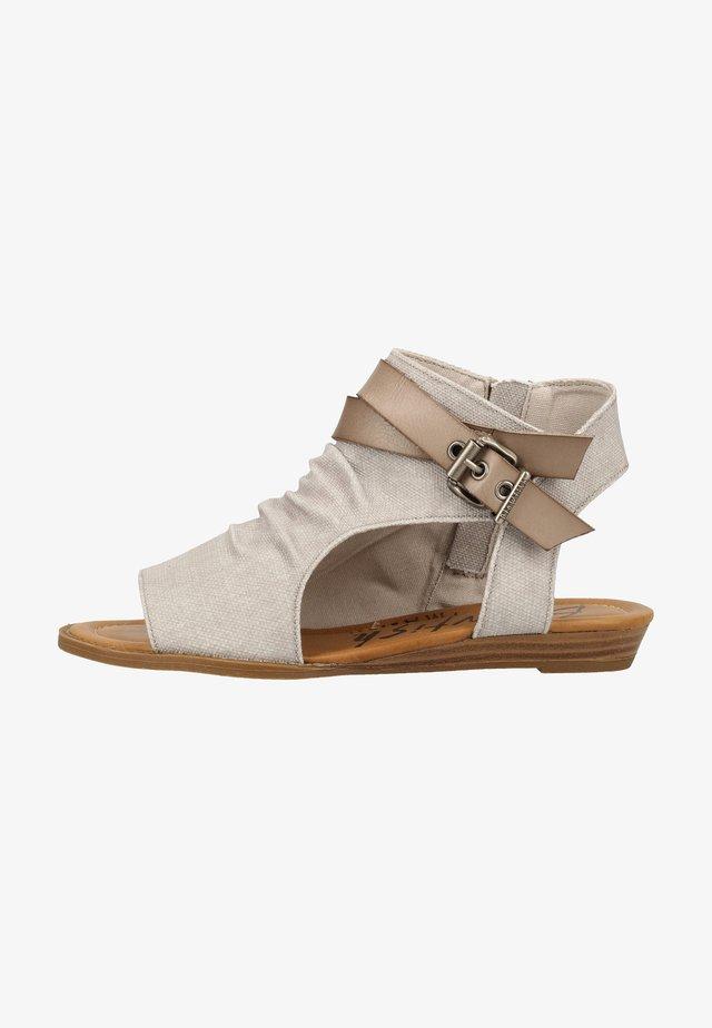 Sandaalit nilkkaremmillä - grey